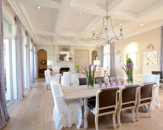 Large white and cream living and dining room, with subtle touches of purple on the dining table