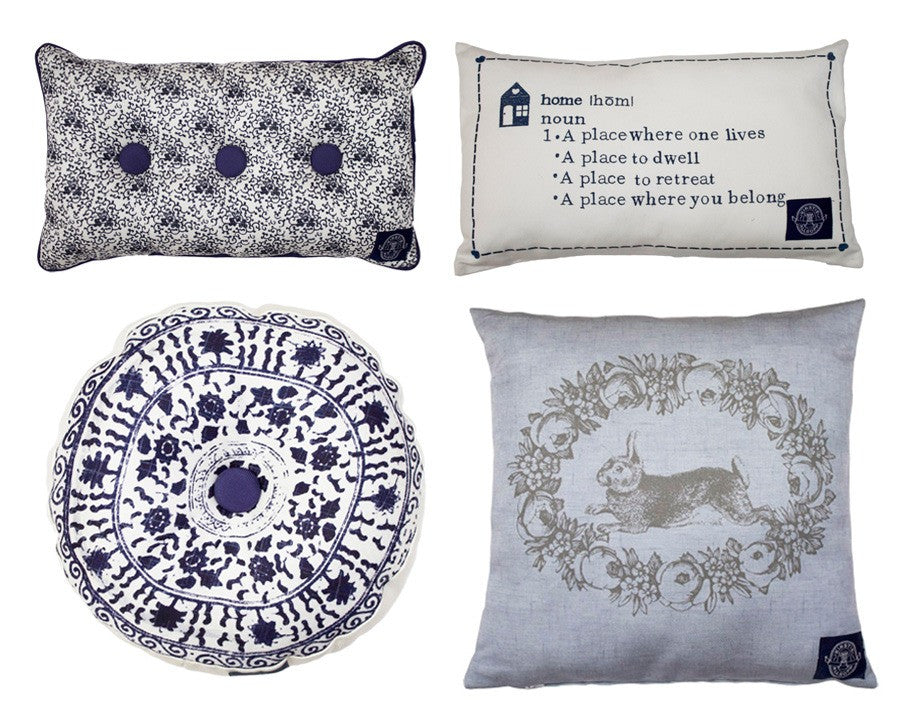 Four different cushions in blue and white, in different sizes and styles
