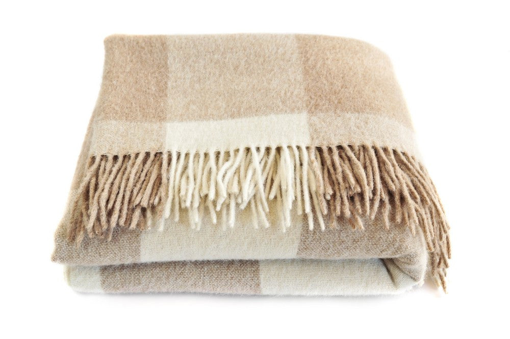 Beige And Cream Throw Folded Into A Square Bundle