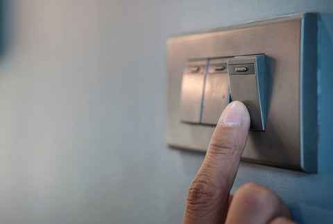 Finger Pressing A Light Switch