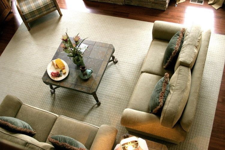 Two Suede Sofas Tiled Coffee Table And Cream Rug Seen From Above