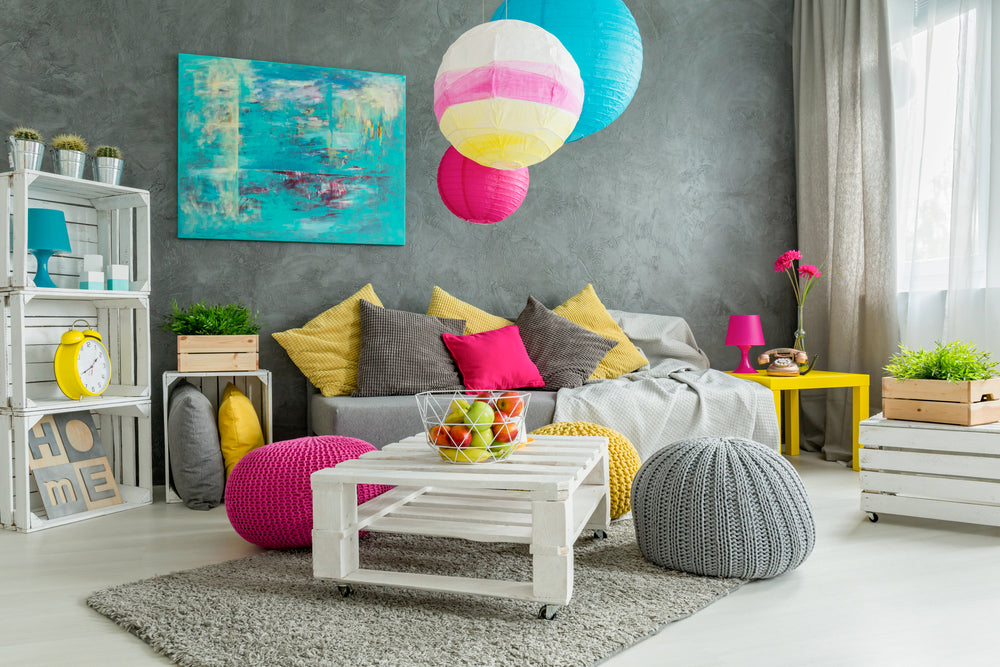 Grey living room with lots of bright accent colours