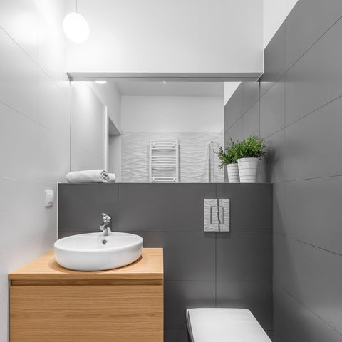 Modern bathroom in grey and white, with wooden sink base