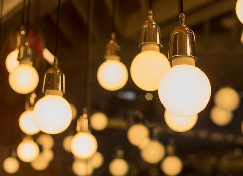 Array Of Hanging Round Solid White Bulbs