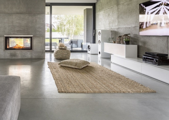 Ultra Modern Living Space, With Concrete Floors And Walls And A Natural Tuft Rug