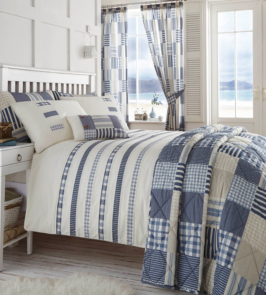 Cream bedding with striped and checked blue patterned
