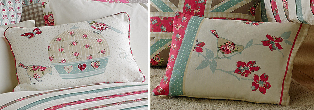 Closeup of two cream, pink and duck egg blue cushions