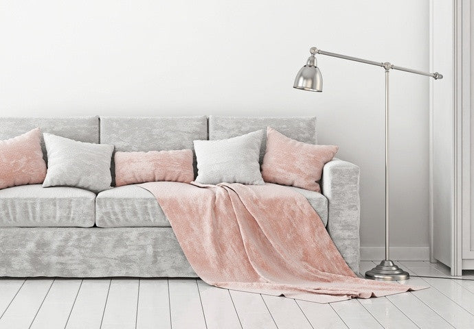 Salmon Pink Throw And Cushions On A Grey Sofa, With An Equal Number Of Grey Cushions