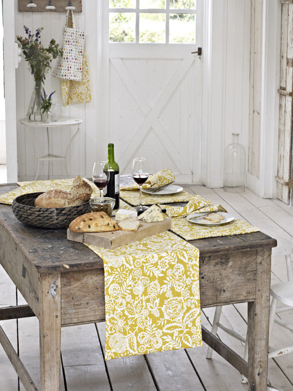 Rustic French dining table in matching kitchen