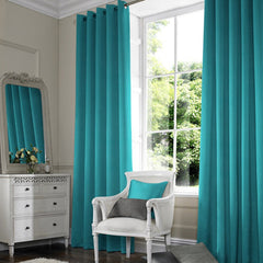 Teal eyelet curtains in a window