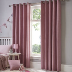 Mink dark pink eyelet curtains in a bedroom