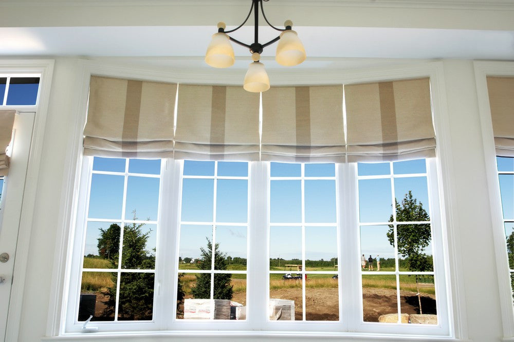 Roman Blinds In Window