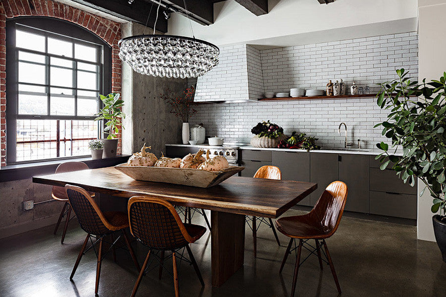 Rustic kitchen with white tiles, and brown accent colours and exposed brickwork