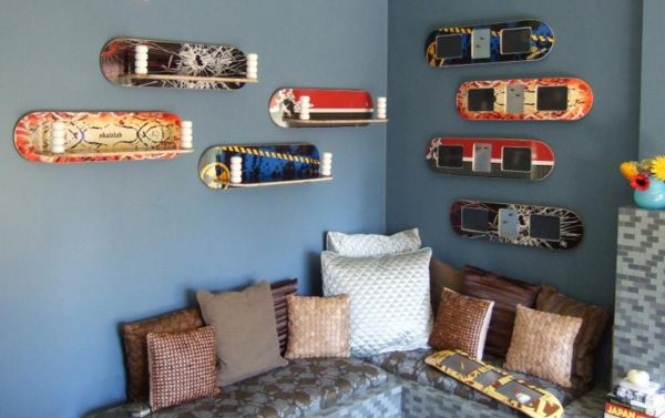 Dark blue bedroom with different skateboards mounted to the wall
