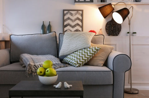 Grey Sofa, Green Cushion And Two Headed Black Floor Lamp
