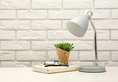 Grey Table Lamp, Plant, Glasses And Book