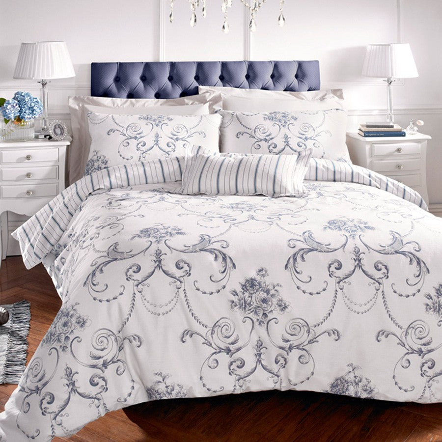 White bedding with a swirling dark blue floral design