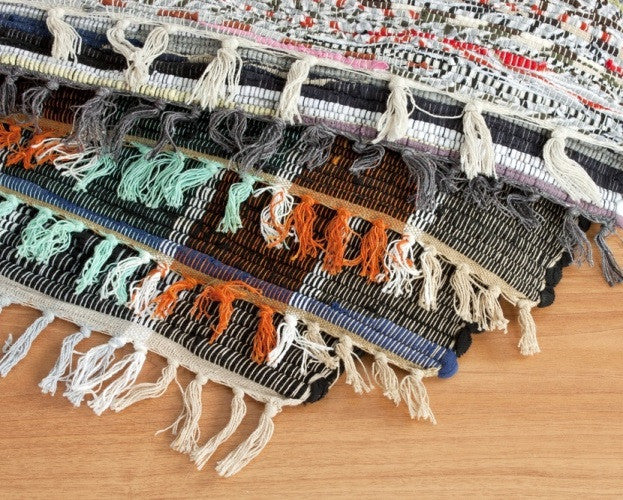 Pile Of Rugs with String-like Tasselled Edges