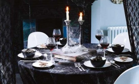 Gothic black dining table with cobweb decorations