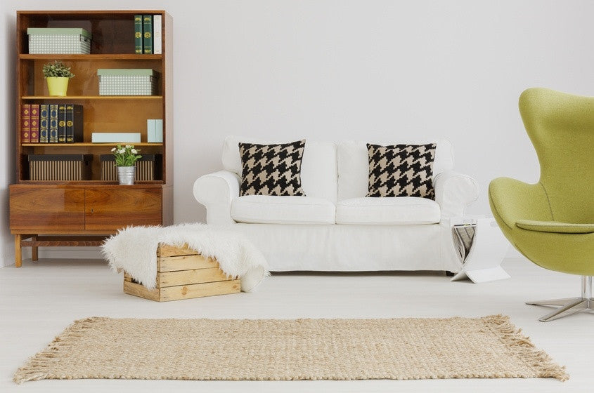 Tuft Rug On white Floor, In Front Of White Sofa And Traditional Cabinet