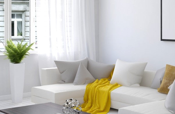 Yellow Throw On Top Of White Sofa