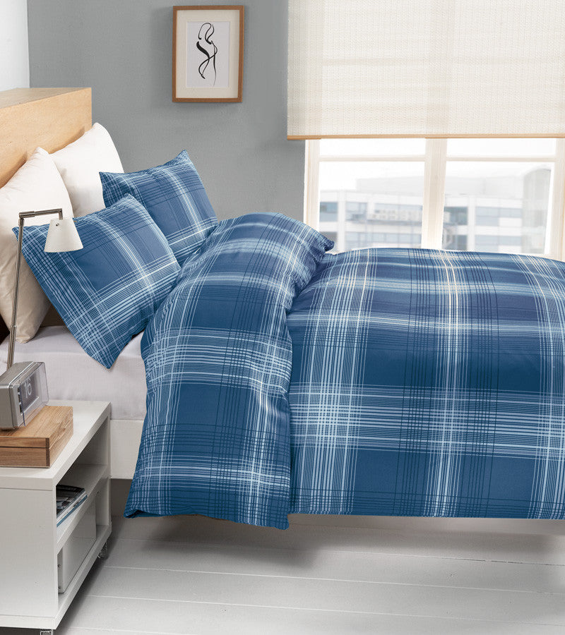 Dark blue bedding with a lighter blue checked pattern