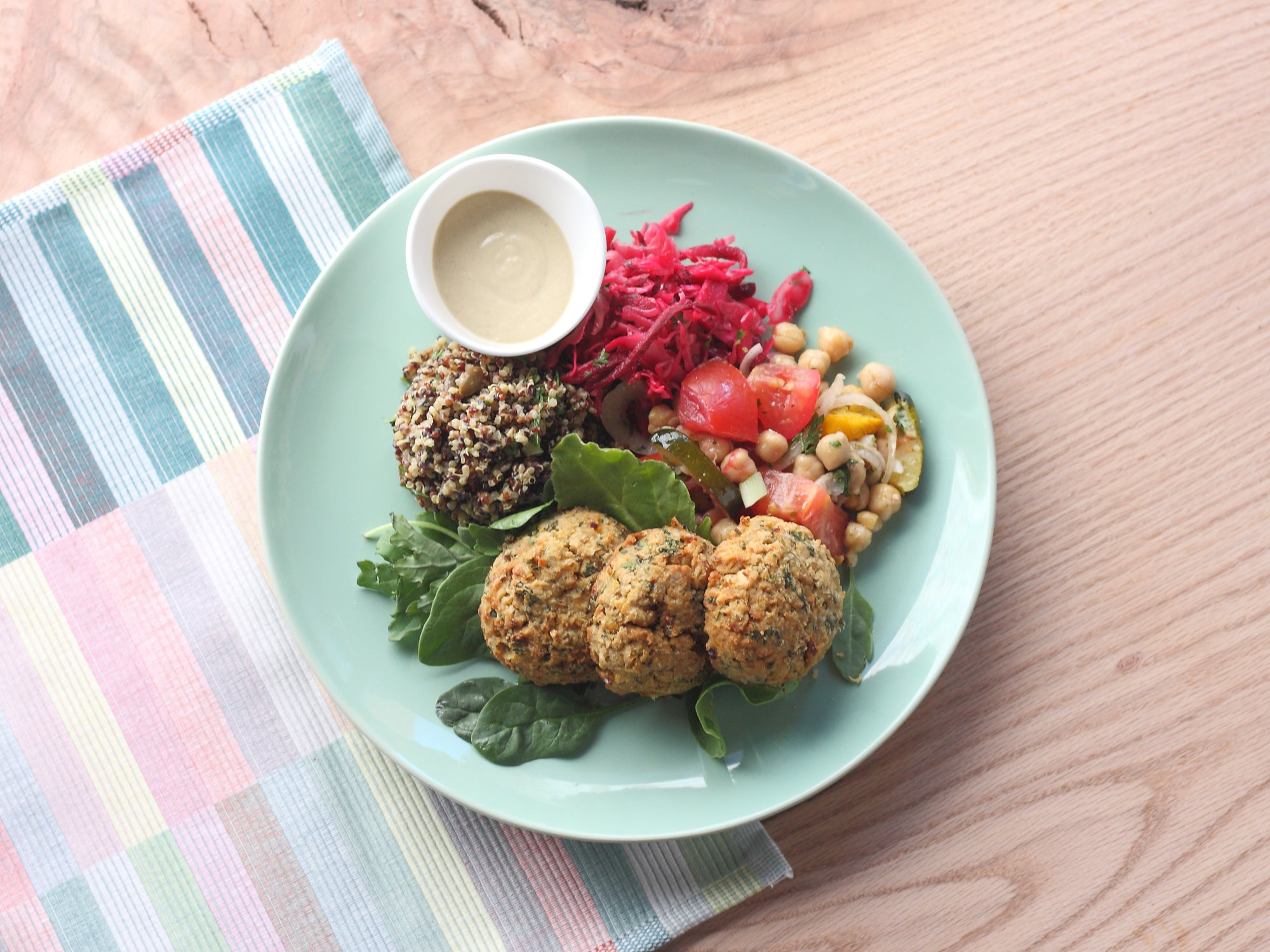 Falafel Platter with Herbed Quinoa Couscous, Local Marinated Veggies, and Aphrodite Dressing