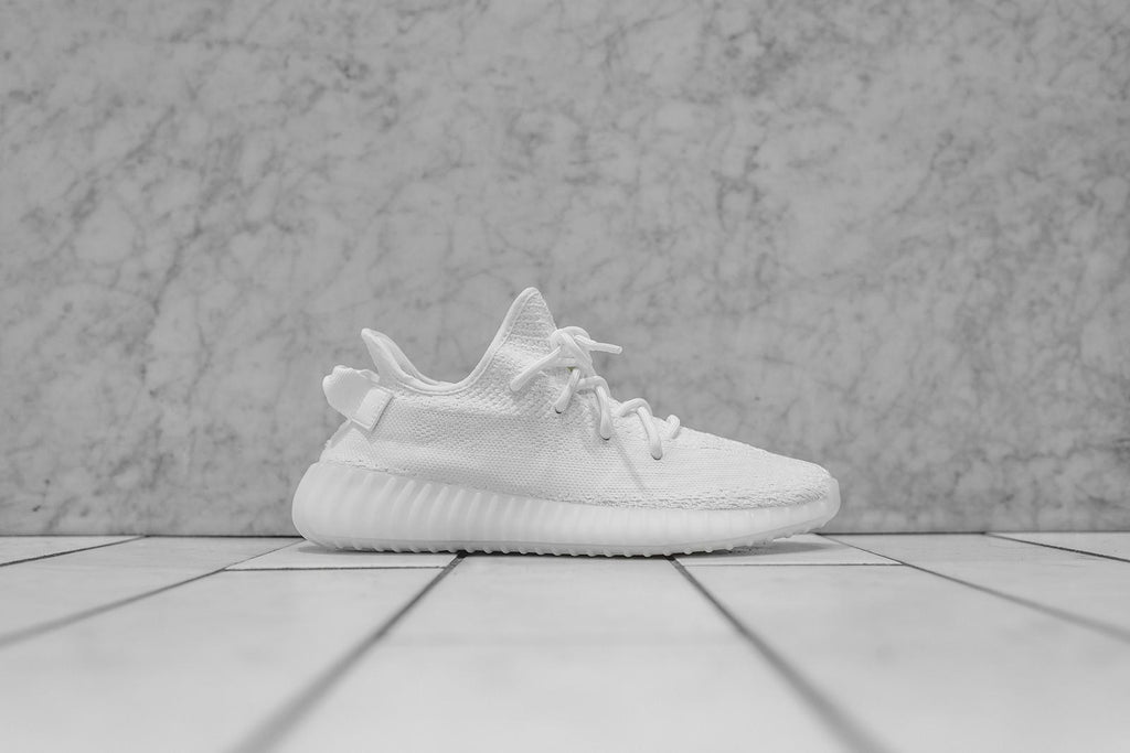 "KANYE WEST CONTINUES DOMINANCE WITH ADIDAS YEEZY BOOST 350 V2 ""CREAM WHITE"" RELEASE"