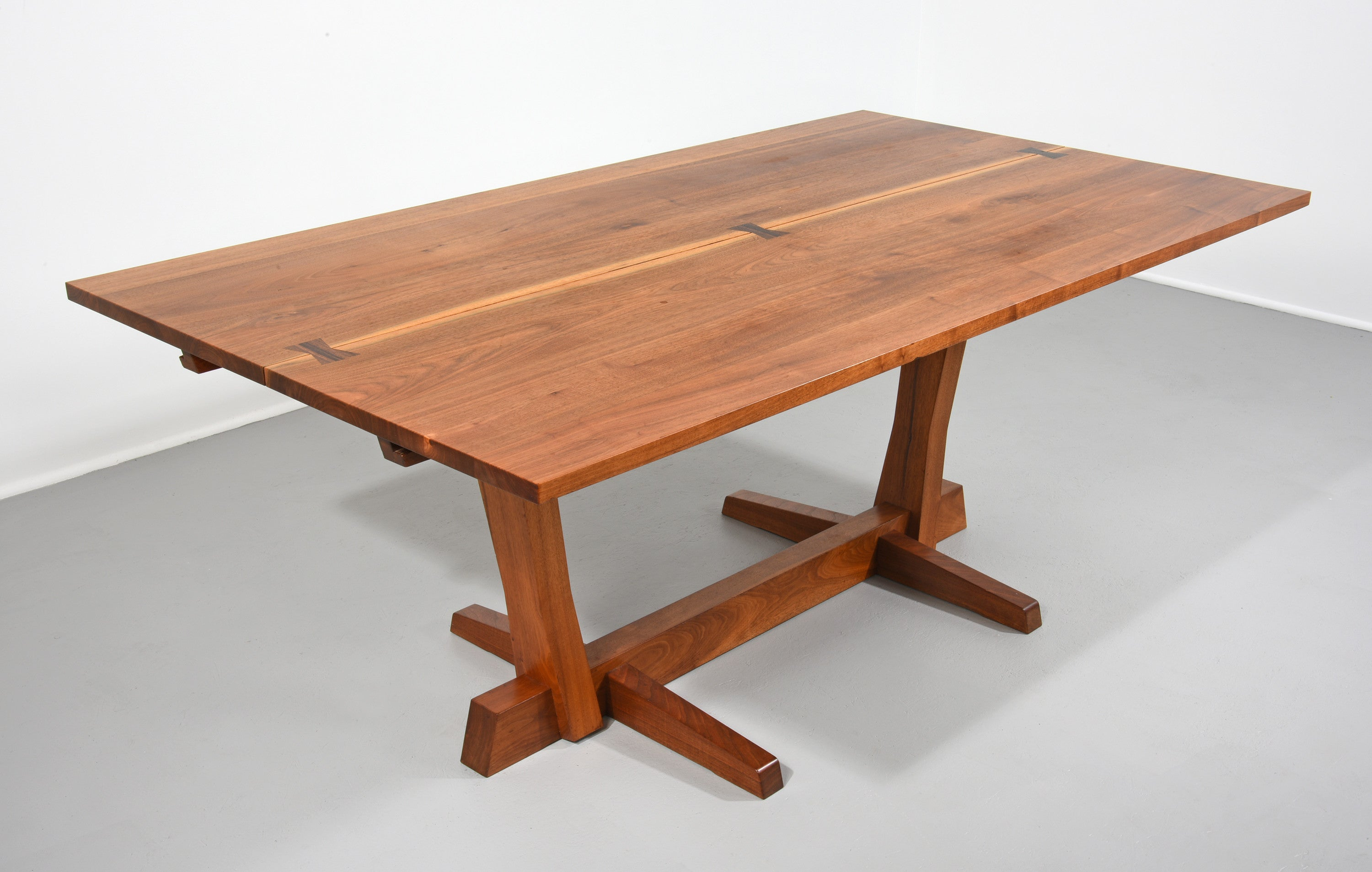 george nakashima conoid dining table in walnut and rosewood the