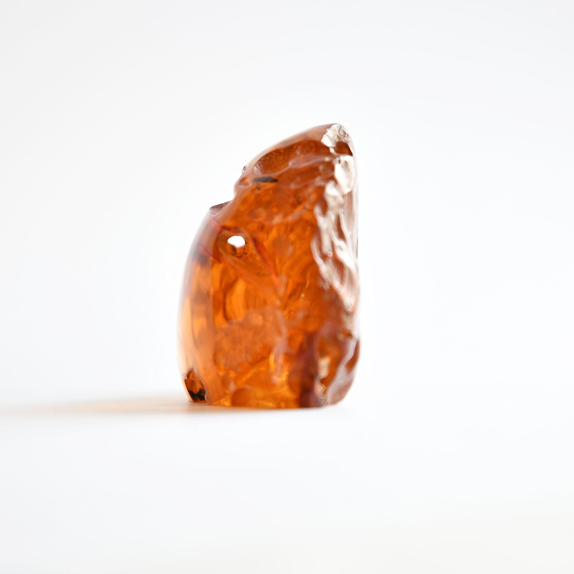 Transparent amber with natural hole