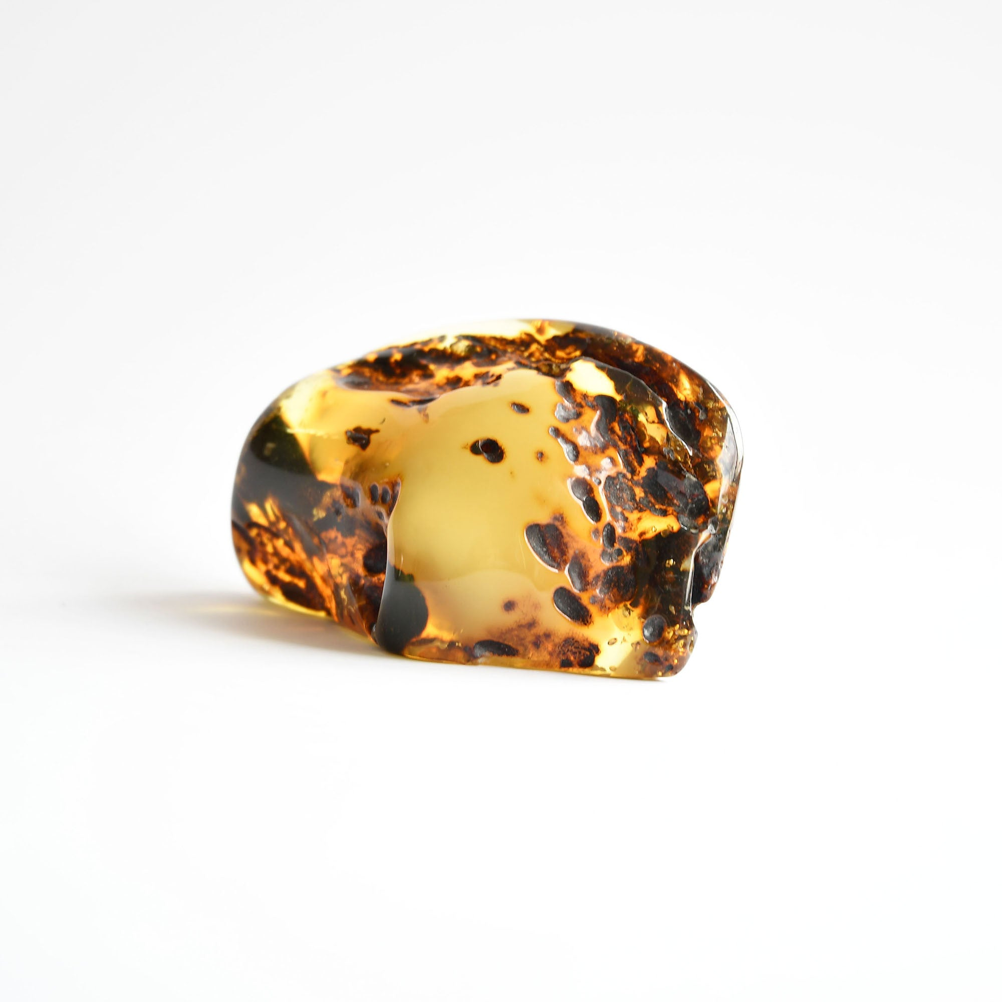 Transparent amber with green pattern