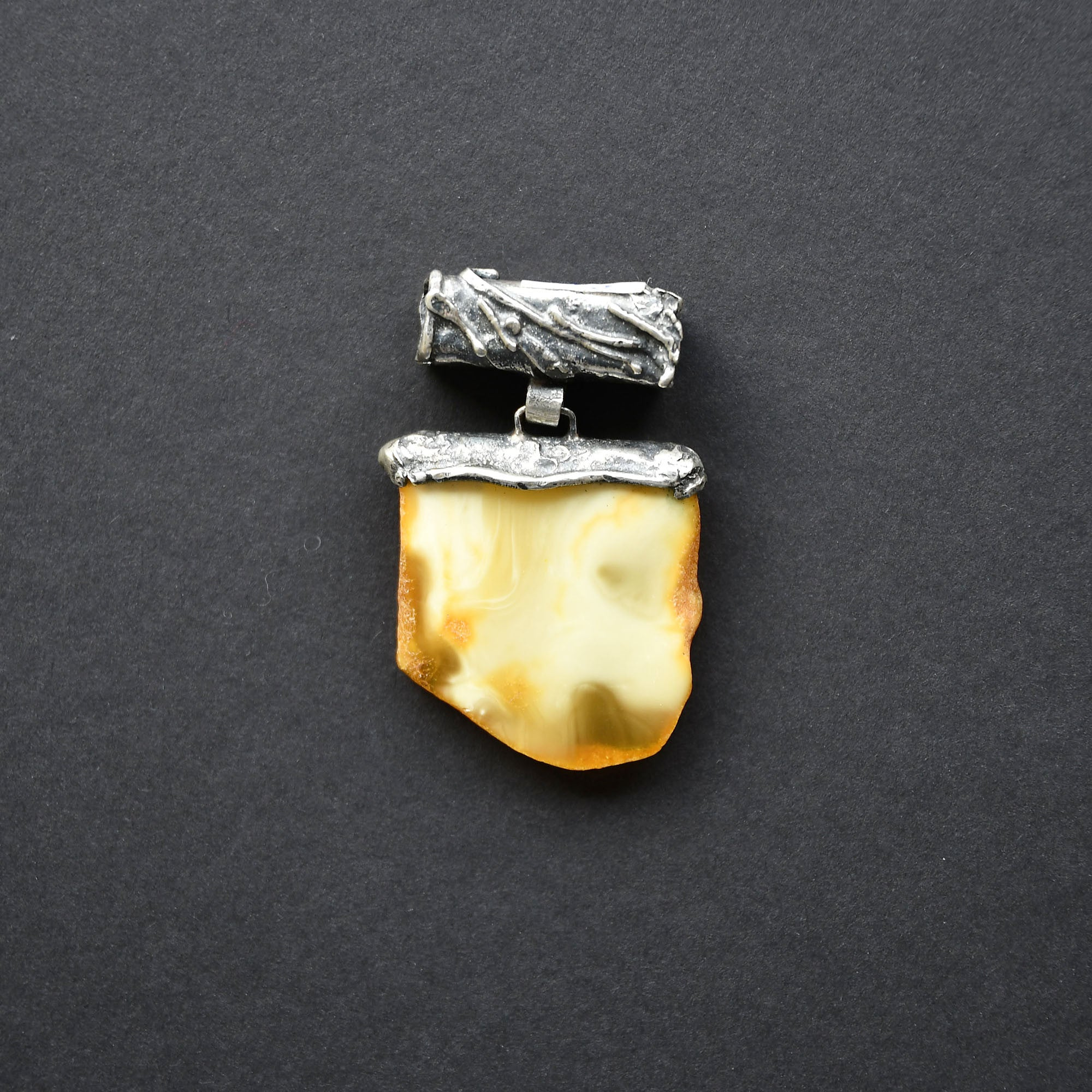 Amber pendant in silver setting with a secret