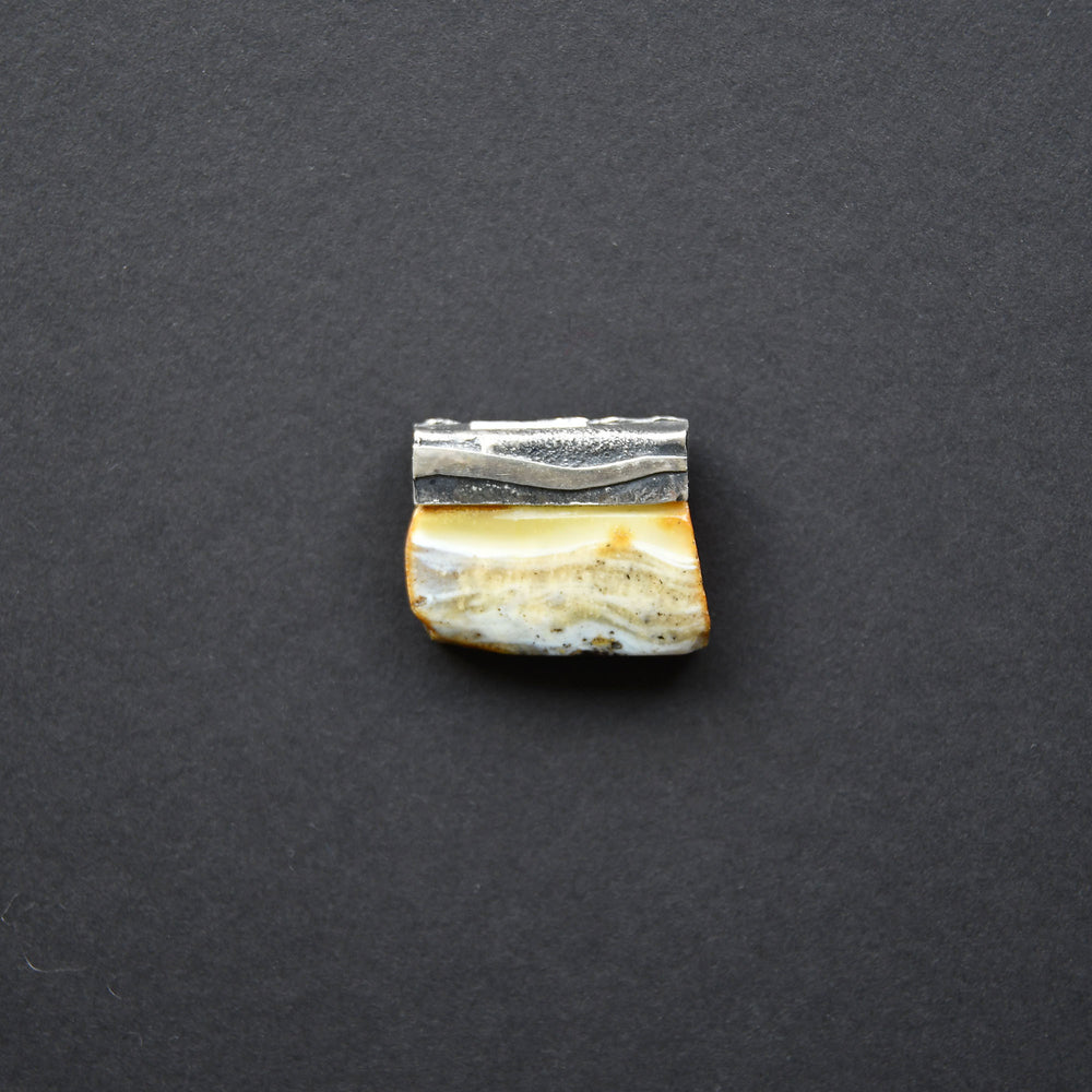 Two-sided amber pendant of rare blue colour in silver setting