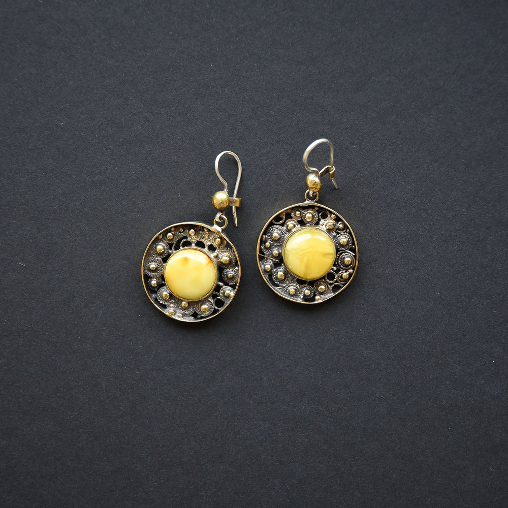 Brass earrings with yellow amber and silver loop