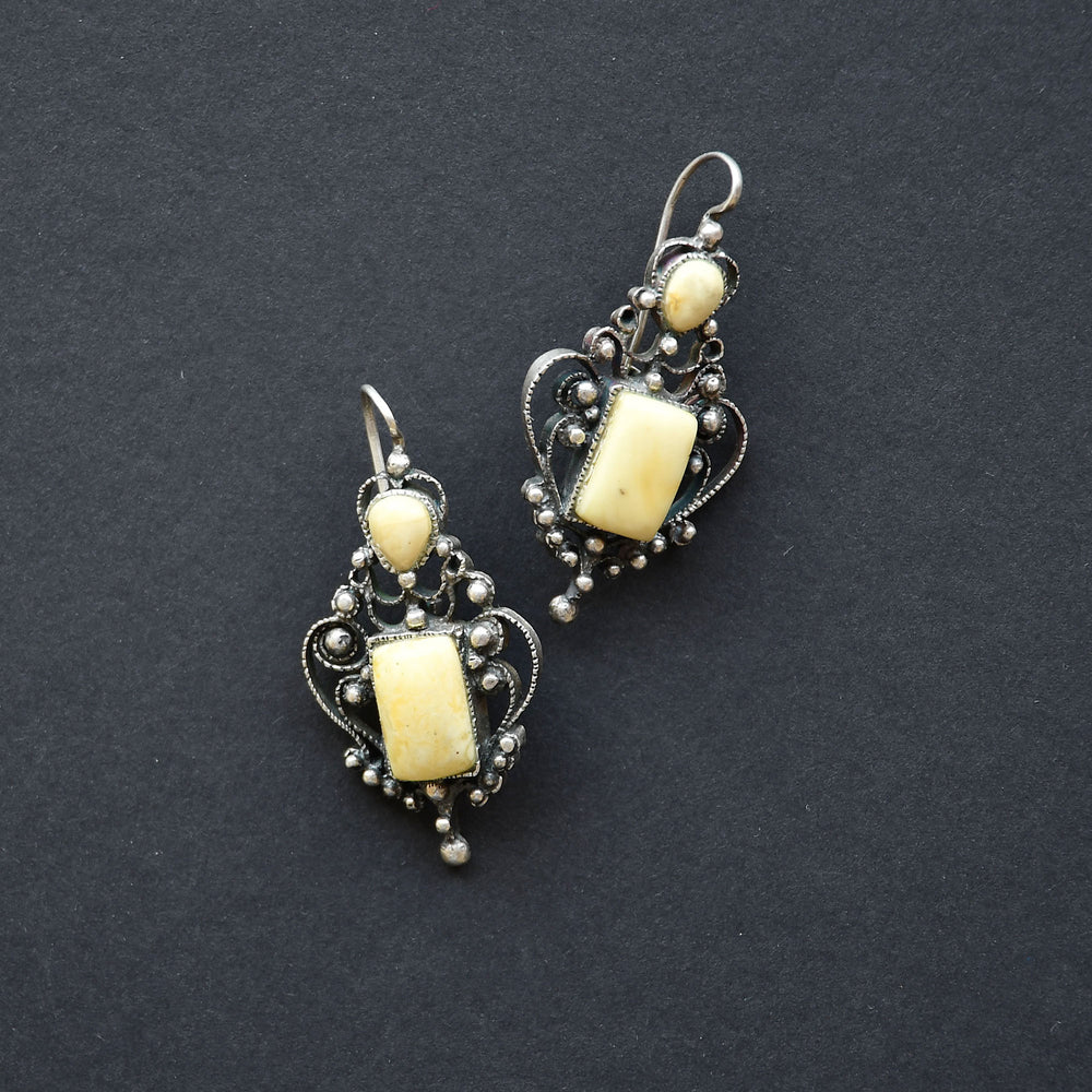 Earrings of white amber and open work filigree
