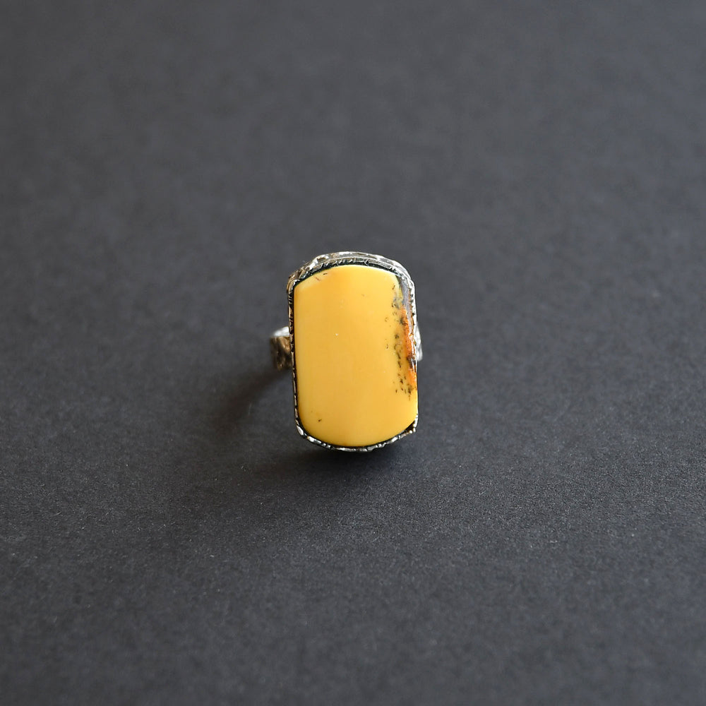 Silver ring with an old orange amber