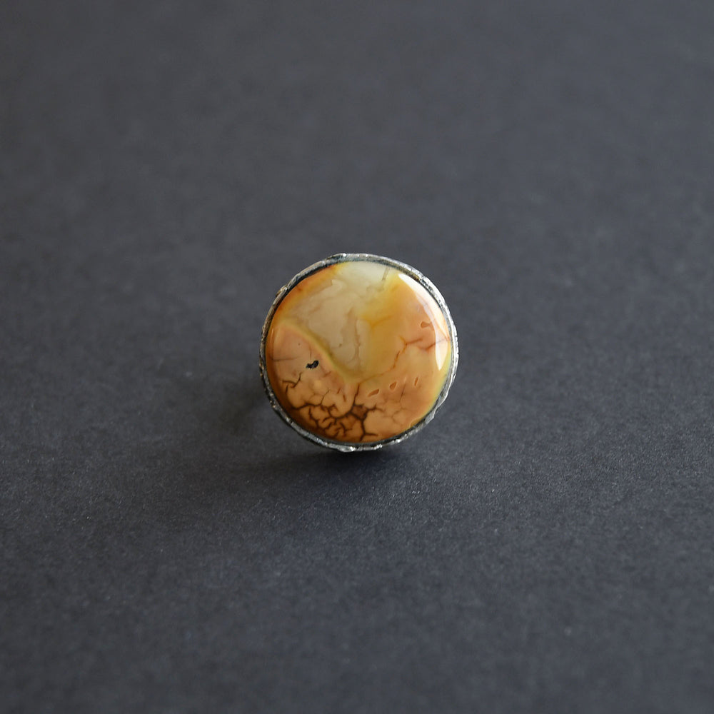 Amber ring of an unusual creamy colour in silver setting