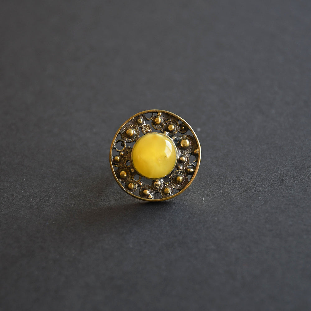 Brass ring with mate yellow amber