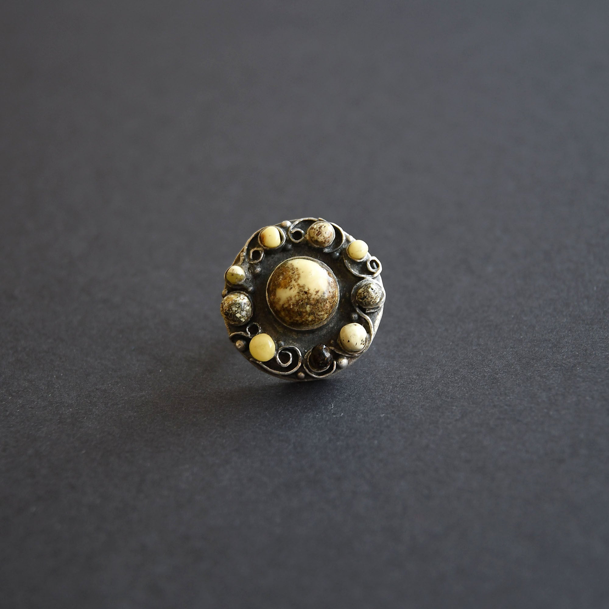 "Silver ring with 10 amber balls ""Parade of planets"""