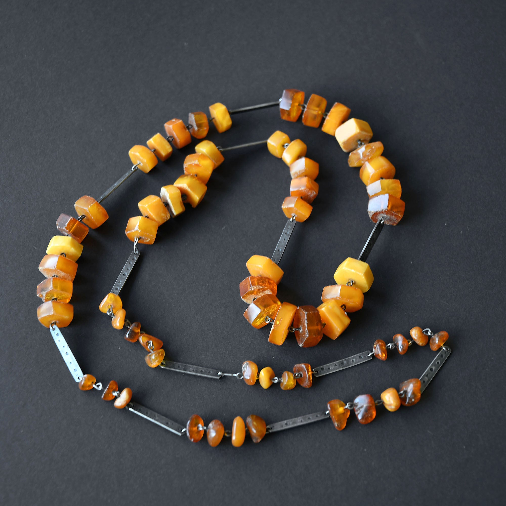Vintage bead necklace of orange and transparent amber