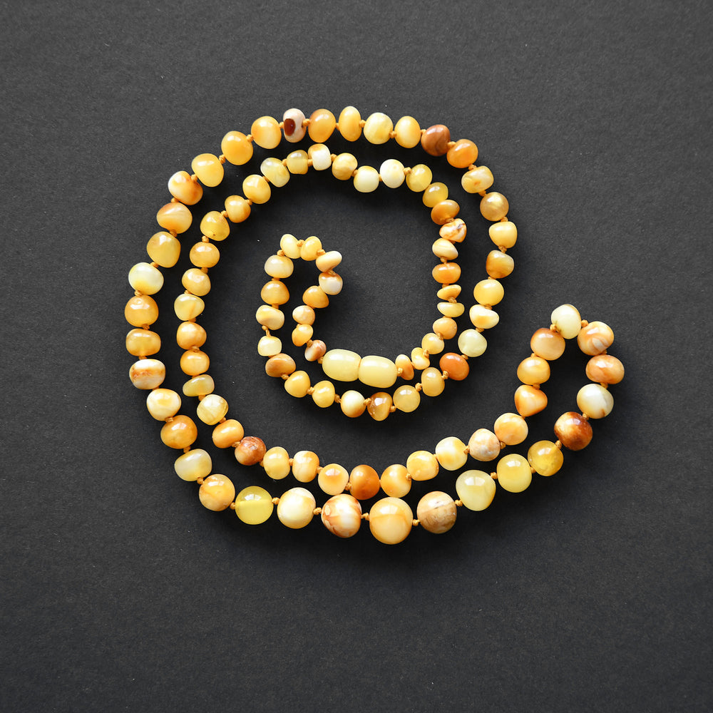 Vintage bead necklace of yellow and orange amber in the form of river pearls