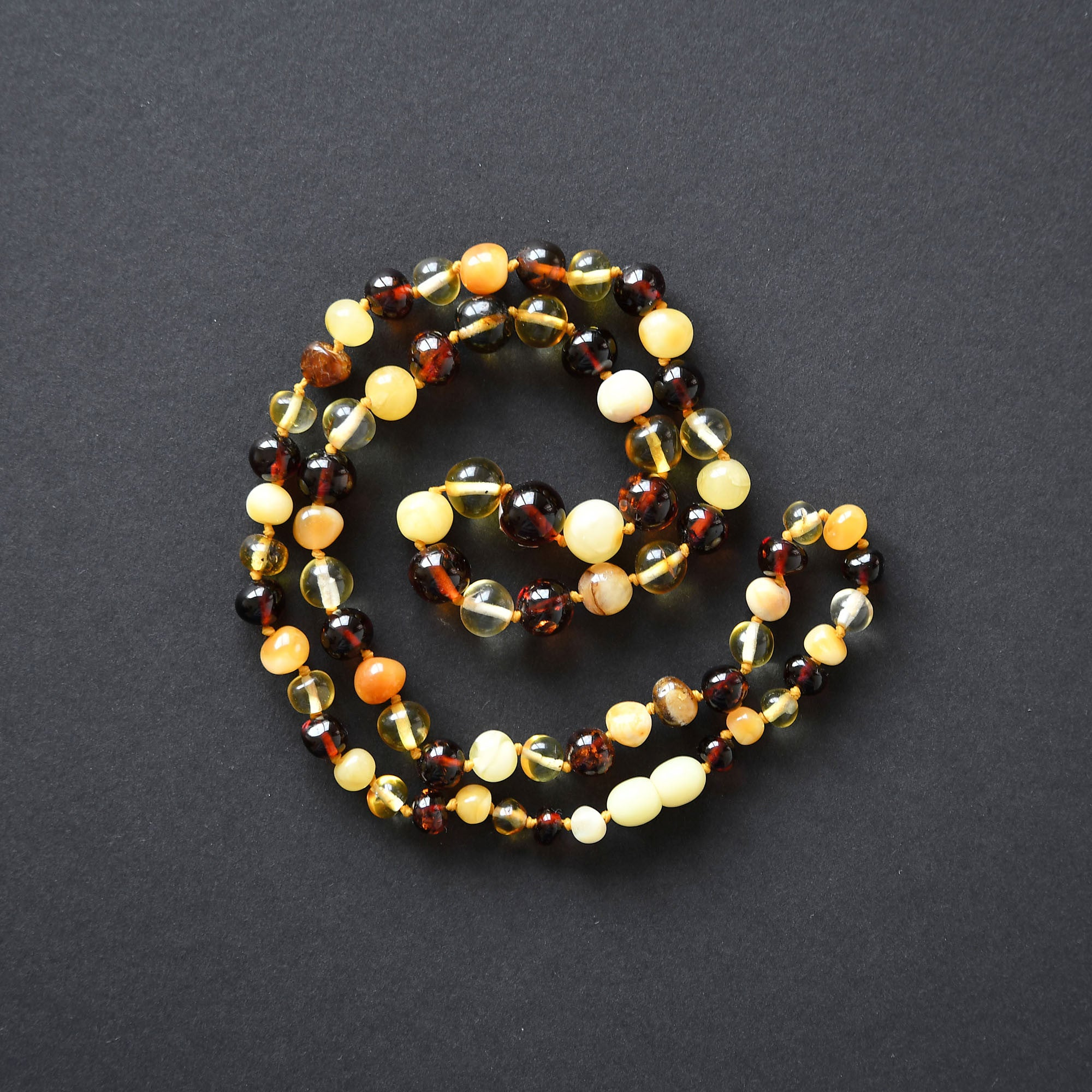 Multicolored necklace of irregular round form