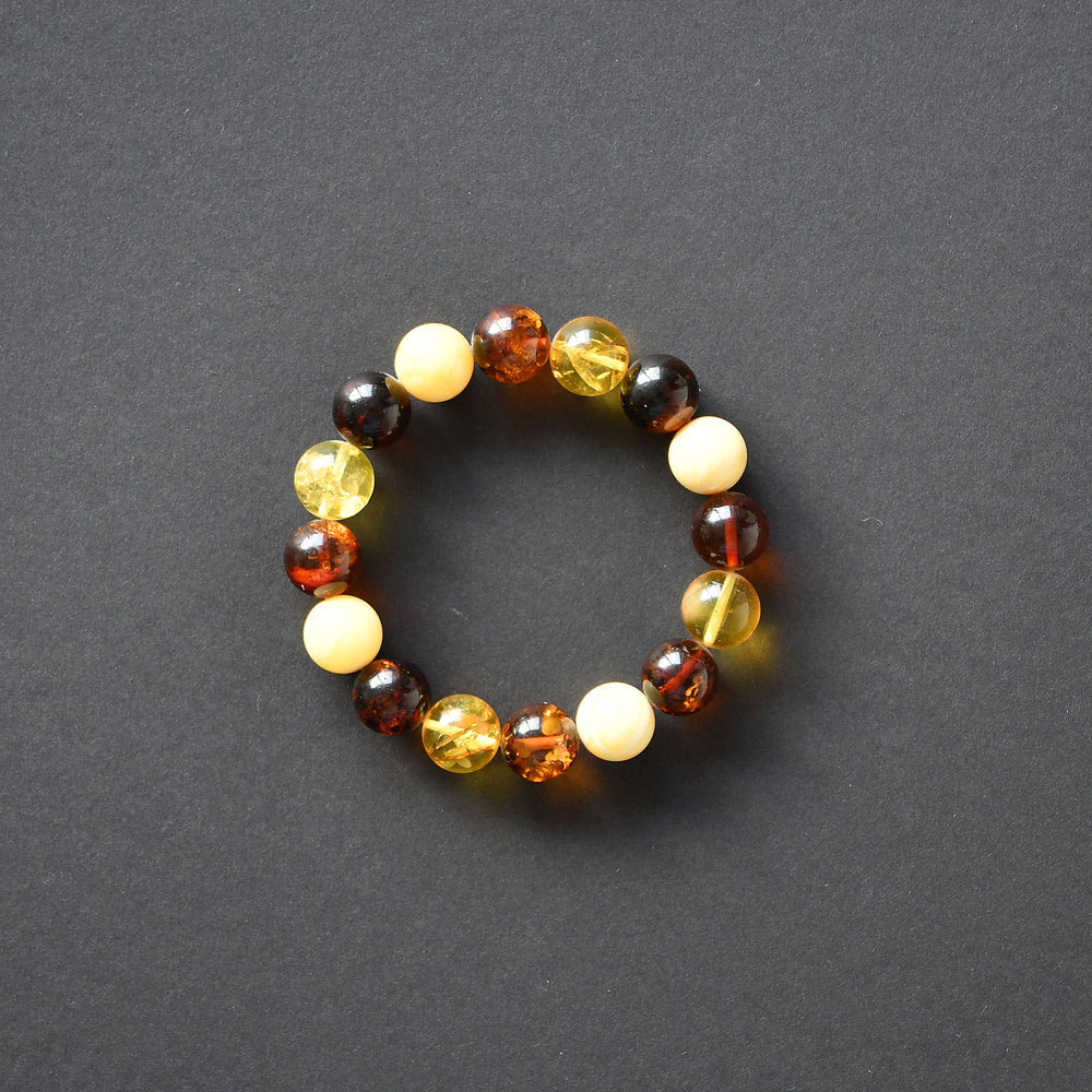 Bracelet of colorful amber balls of a perfectly round form on elastic band