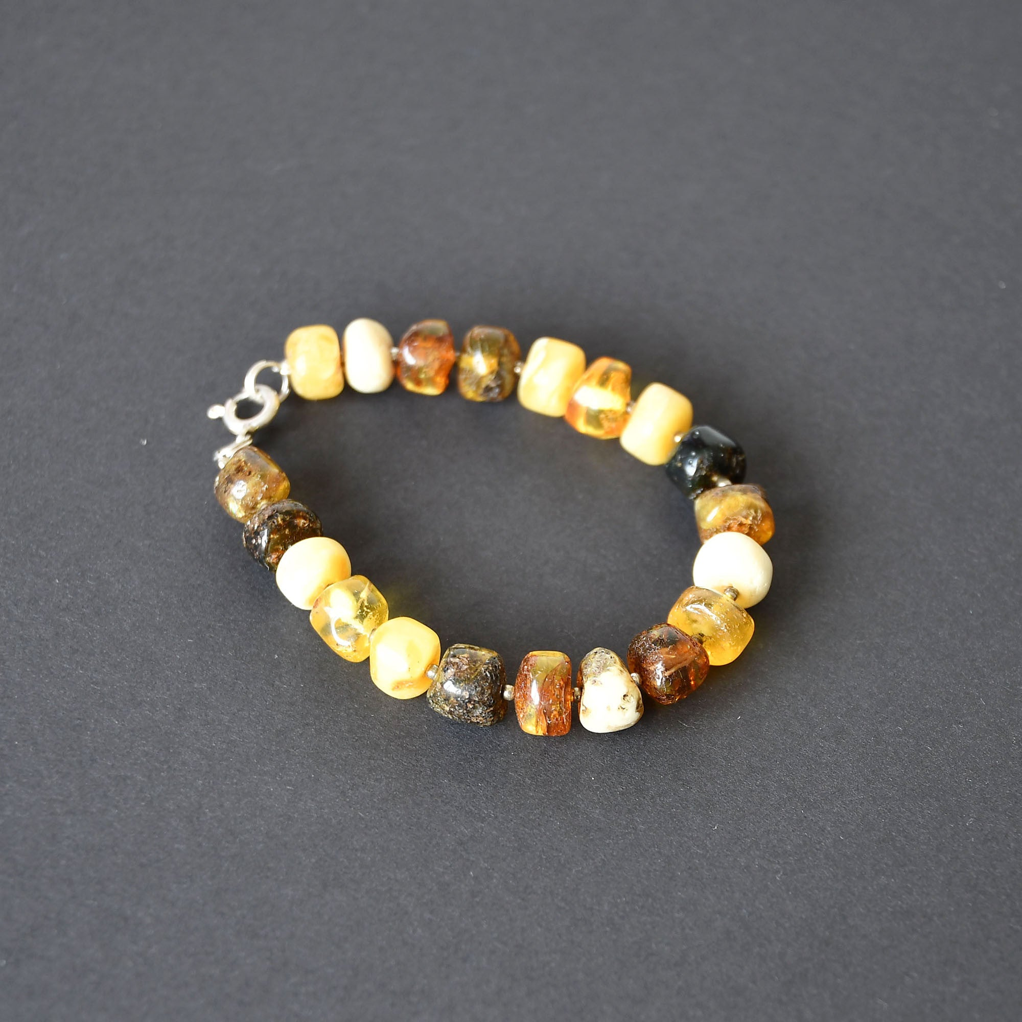 Colorful amber bracelet with a fastening