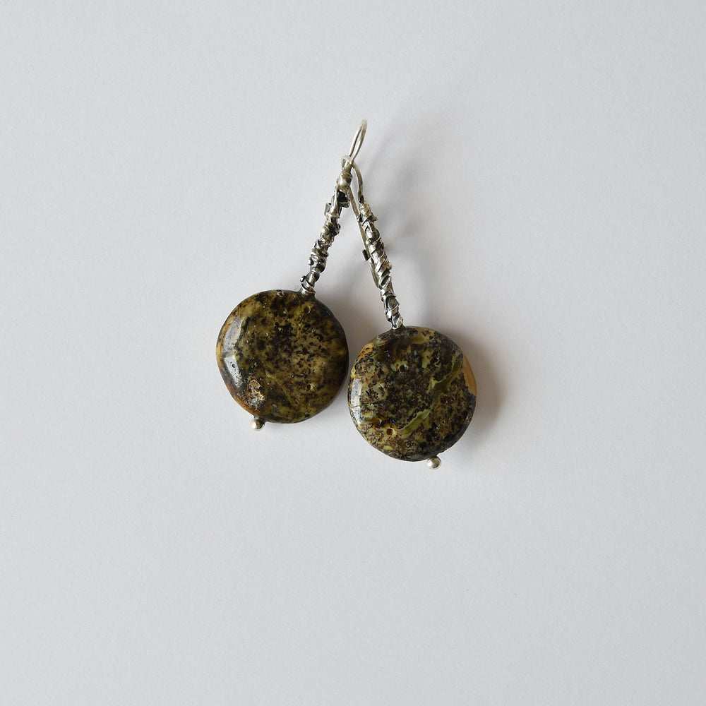 Earrings of grey and black earthy amber with silver fastening