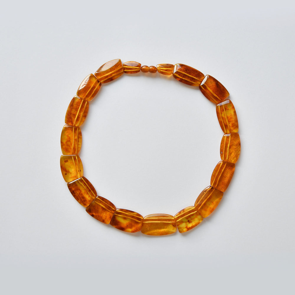 Necklace of transparent amber of the colour of young white honey