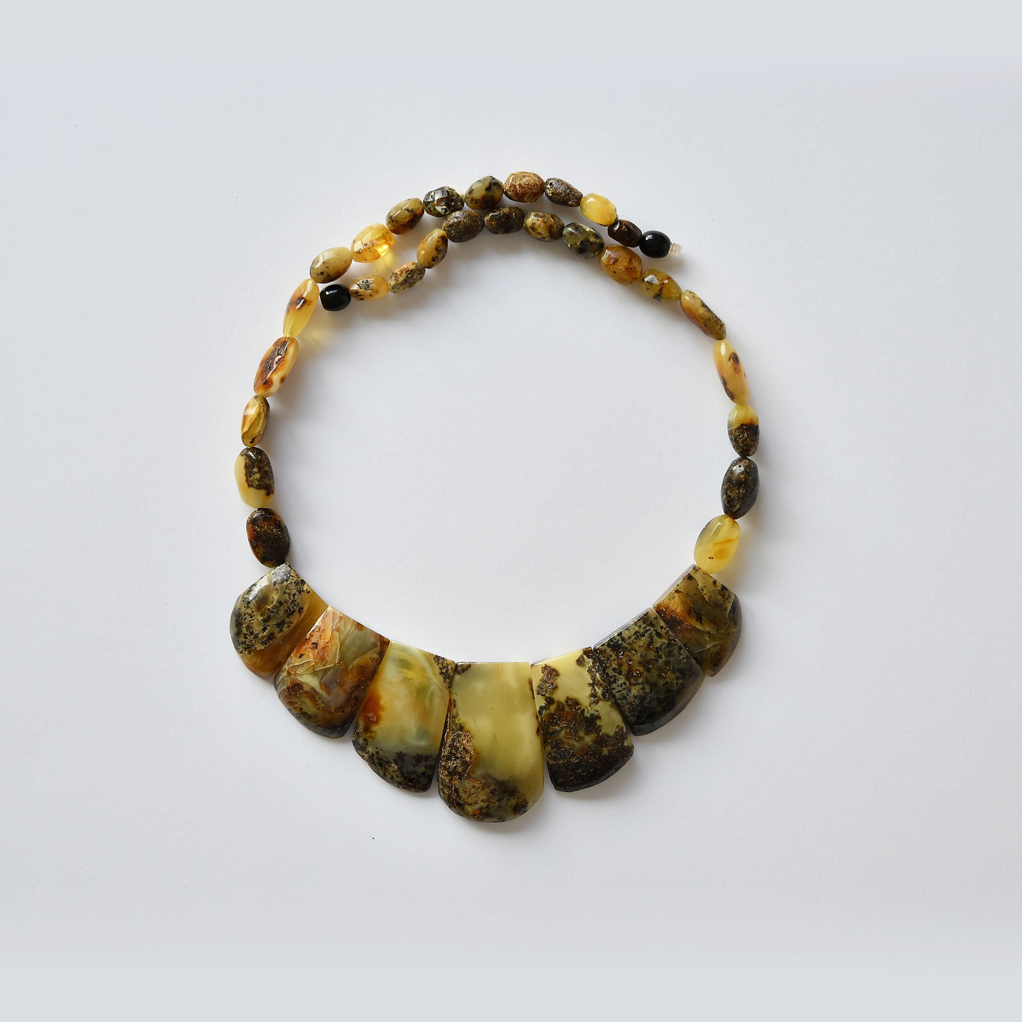 Necklace of earthy amber with green, blue, orange patterns