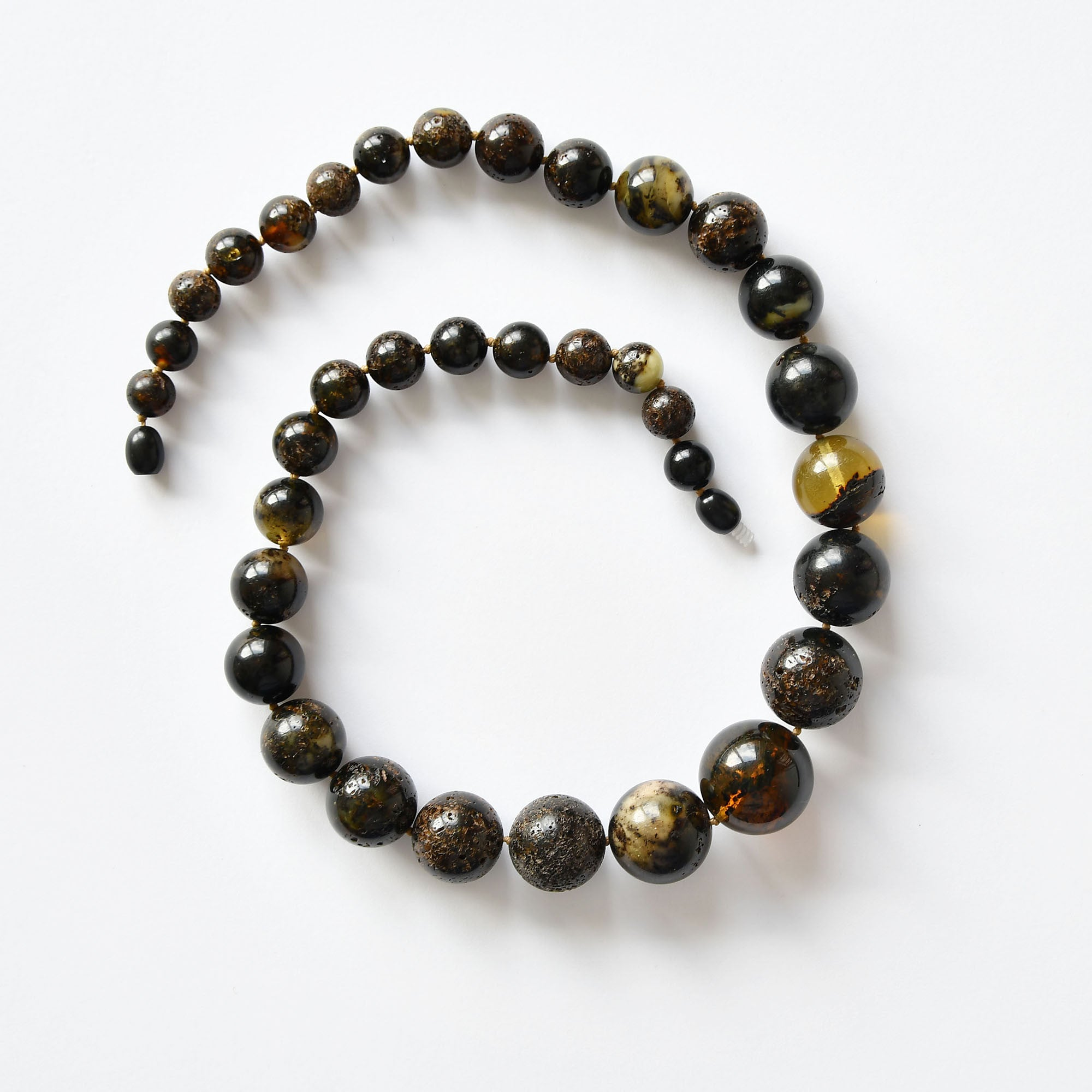 Beads of perfectly round black black amber balls