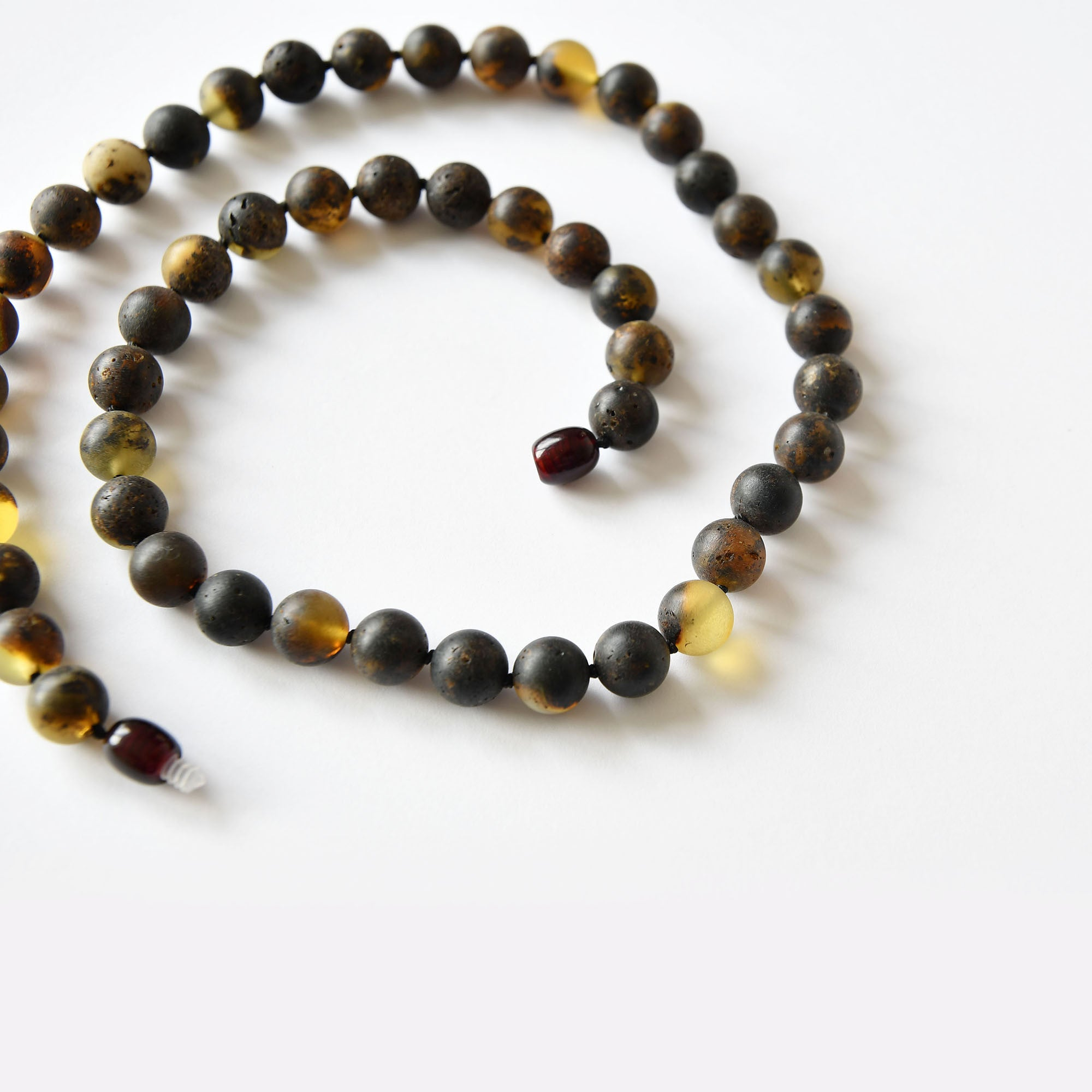 Amber beads of perfectly round black unpolished amber balls