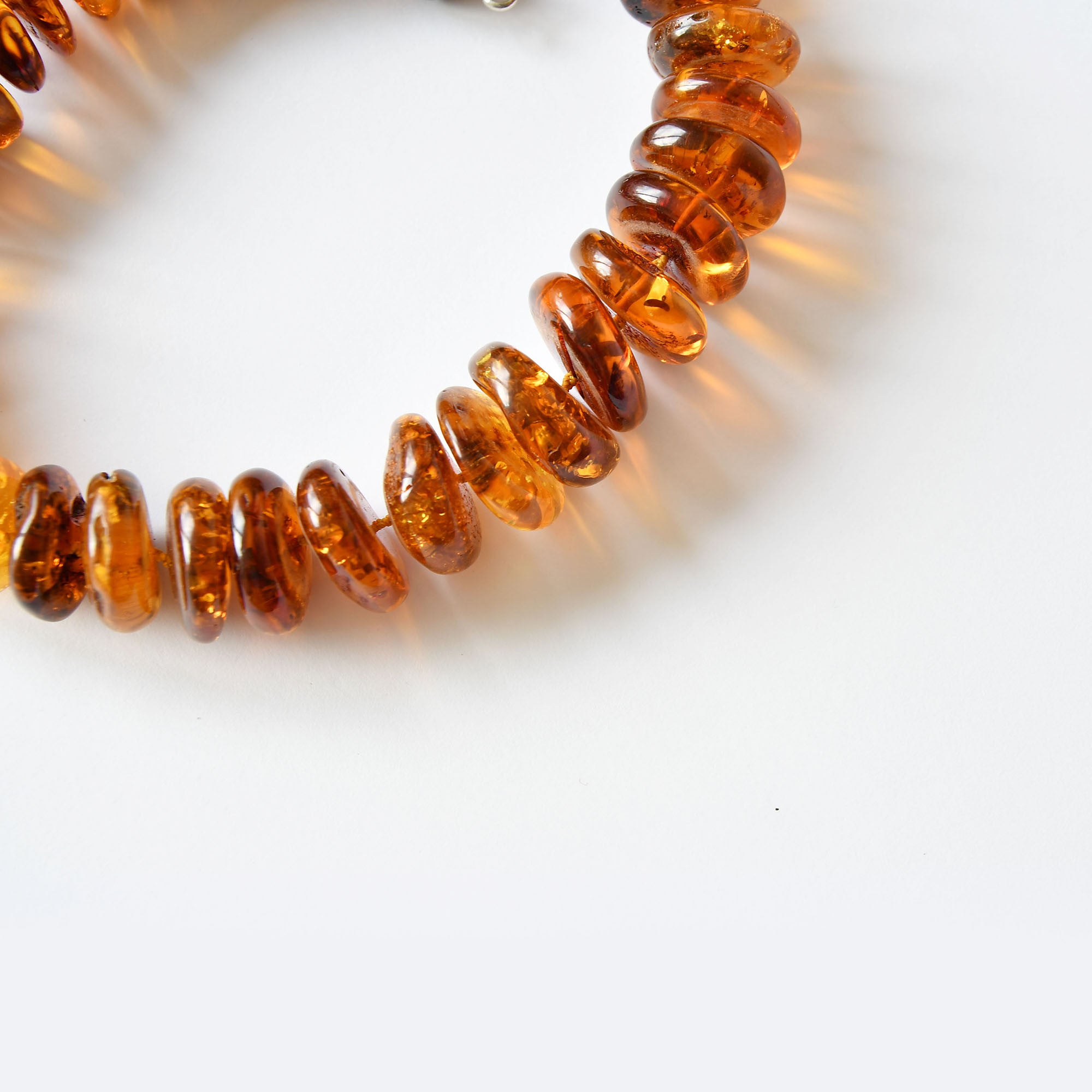 Amber beads of cognac colour with a silver fastening